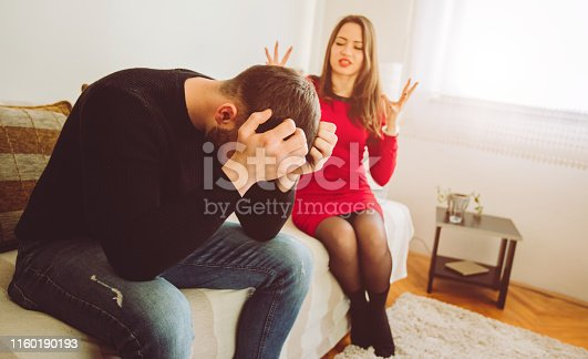 Young caucasian couple fighting at home.
