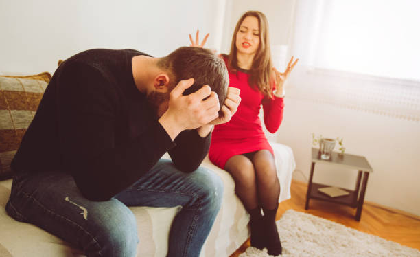 Young couple fighting at home stock photo