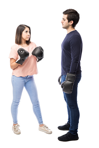 Young Couple Fighting With Boxing Gloves Stock Photo ...
