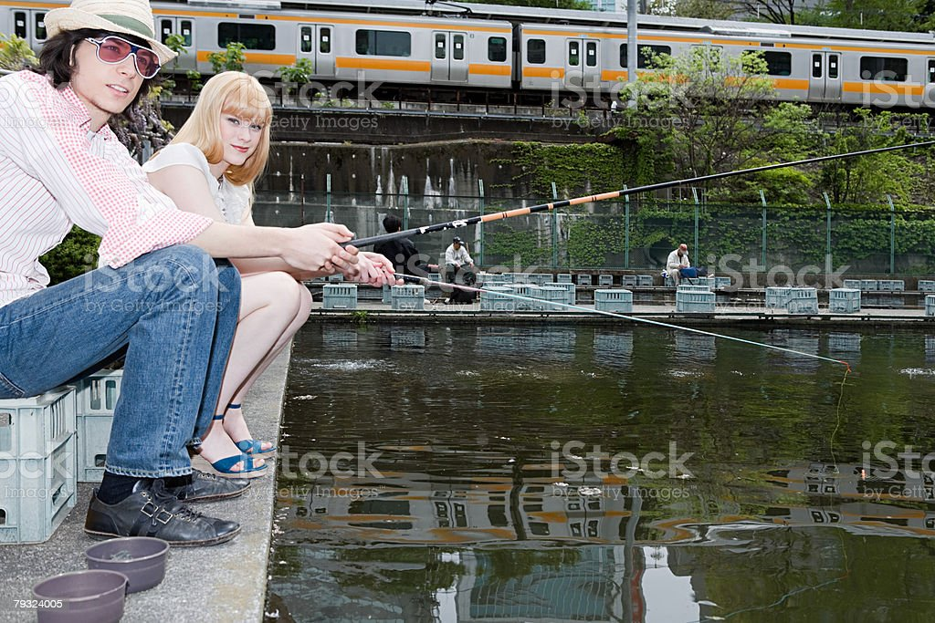 A young couple fishing 免版稅 stock photo