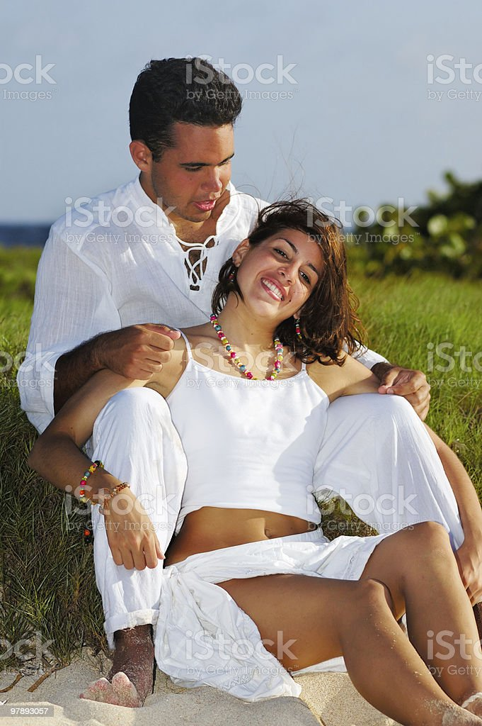 Young couple flirting on a tropical beach royalty-free stock photo