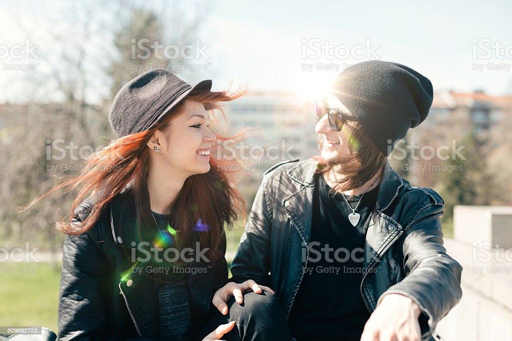 Young couple flirting outside stock photo