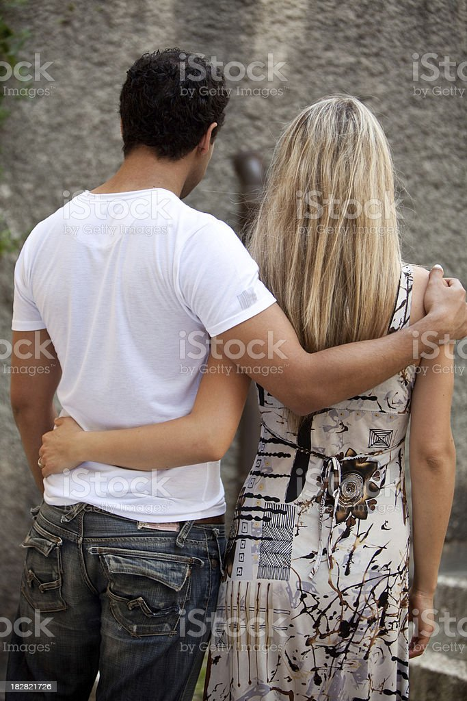 Young couple from behind stock photo
