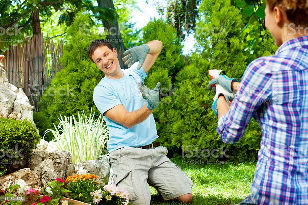 Young Couple Gardening and having fun royalty-free stock photo