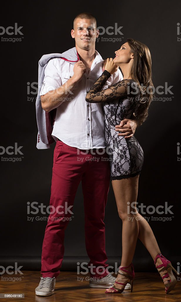 Young couple girl dacner ballerina leaning on boyfriend posing s royalty-free stock photo