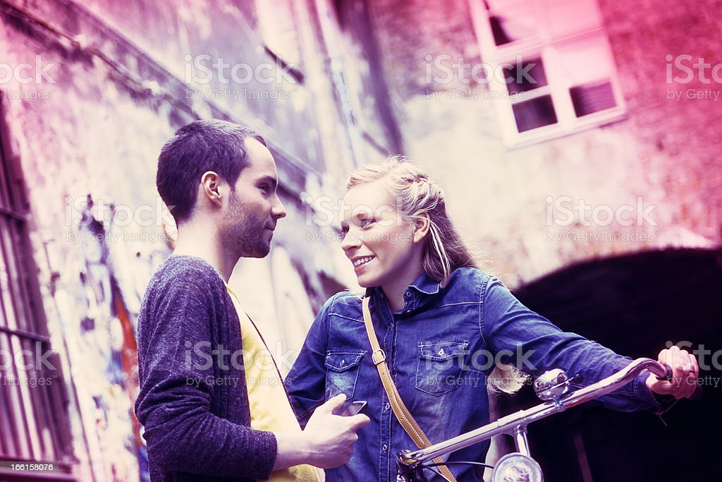 Young Couple Greeting in Alley Cross Process Xpro royalty-free stock photo