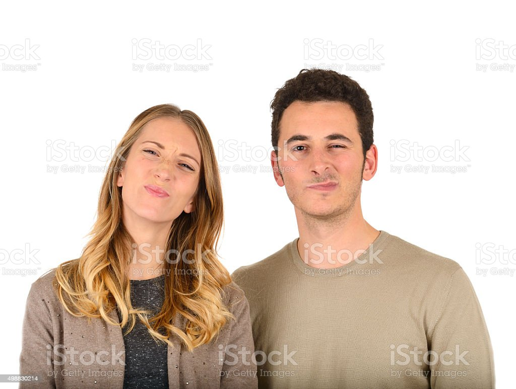 Young couple grimace stock photo