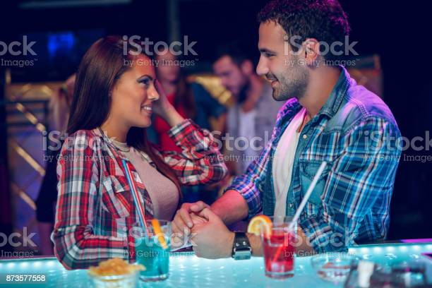 Young couple happily flirting over drinks at night club picture id873577558?b=1&k=6&m=873577558&s=612x612&h=evnozotoy lh jjyxhe34od65e3huyu260e zaybkta=
