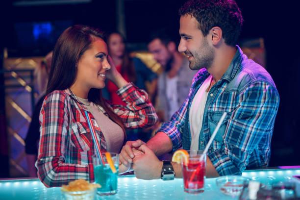 Young couple happily flirting over drinks at night club picture id873577558?b=1&k=6&m=873577558&s=612x612&w=0&h=5jvdfxhe3b0owfmvwju5tz0hzfrnv0mpg3boakx0dpw=