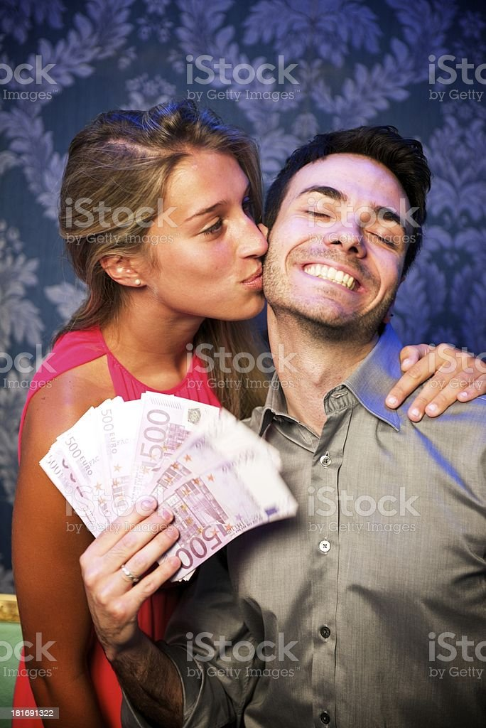 Young couple happy at the casino royalty-free stock photo