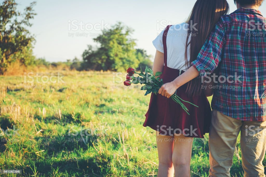 Young couple have fun during the date sunny day in park  Love concept royalty-free stock photo