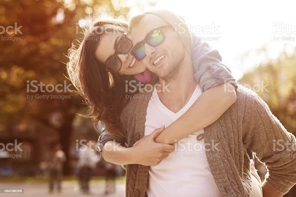 Young couple have fun in sunny day stock photo