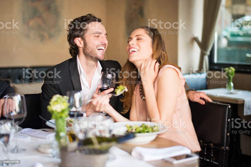 Young couple having a meal at restaurant royalty-free stock photo