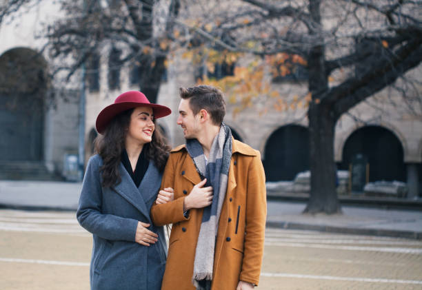 Young couple having a pleasant walk in the city stock photo