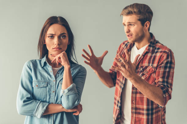 young couple having a quarrel - fighting stock photos and pictures