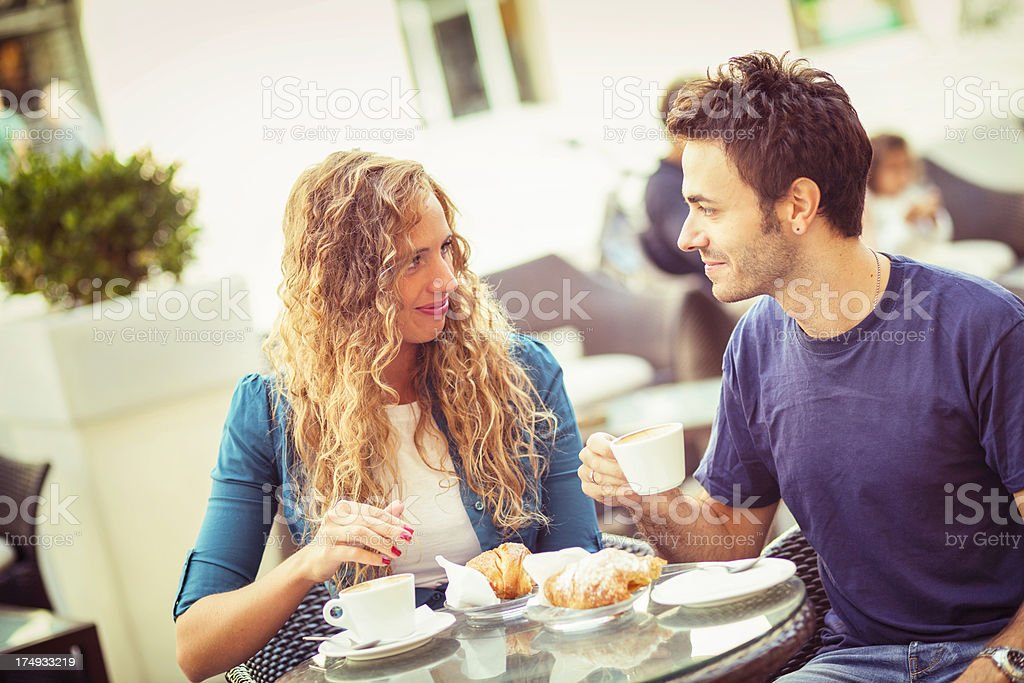 Young Couple Having a Traditional Italian Breakfast royalty-free stock photo
