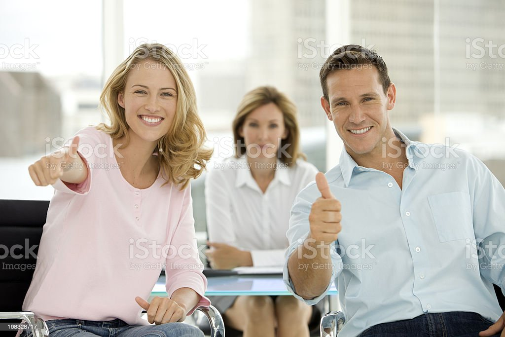 Young couple having an agreement at the bank stock photo