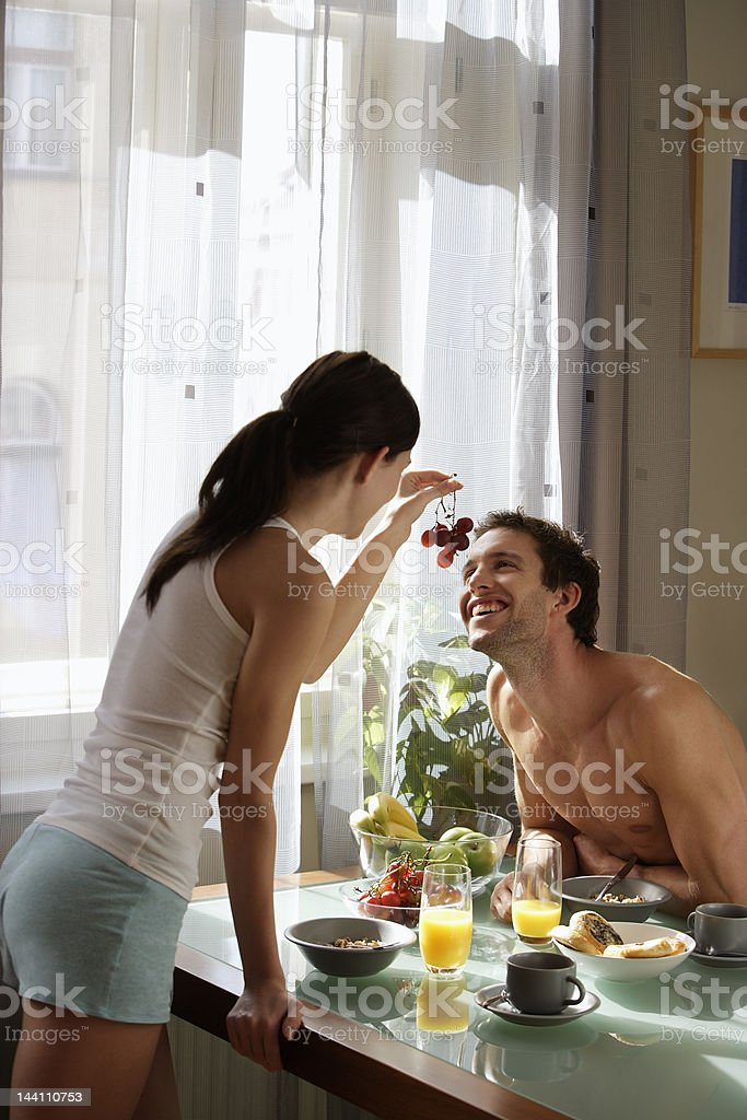 Young couple having breakfast royalty-free stock photo