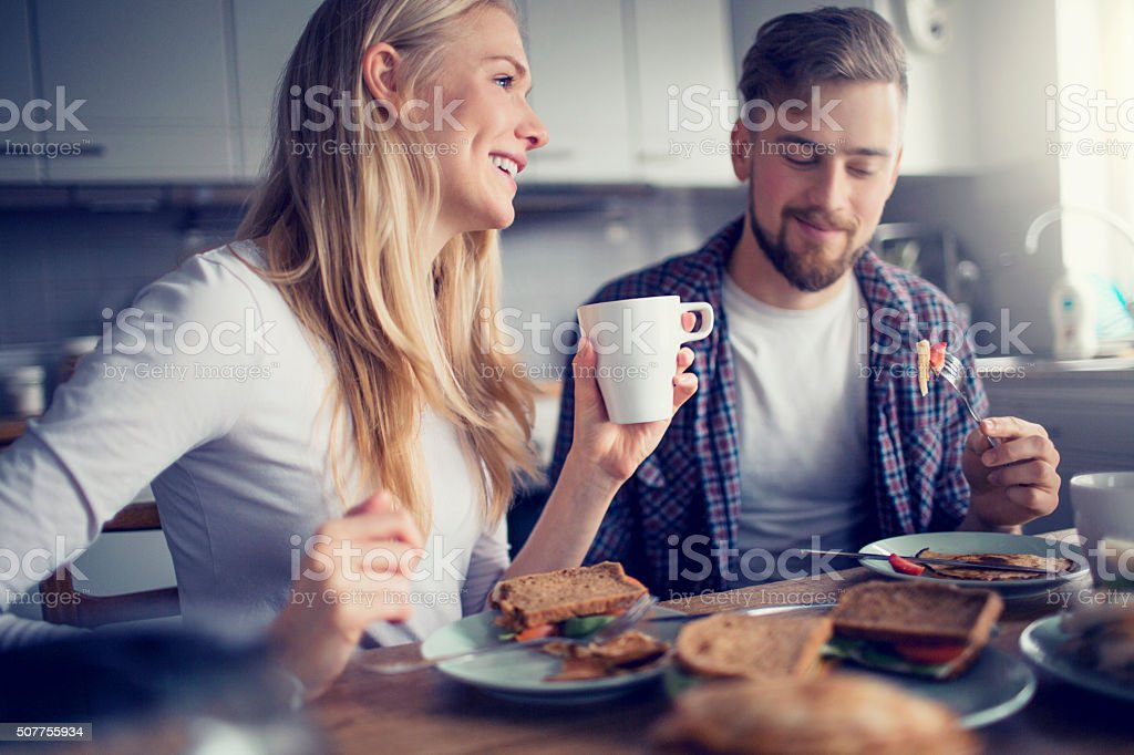 Young couple having breakfast bildbanksfoto