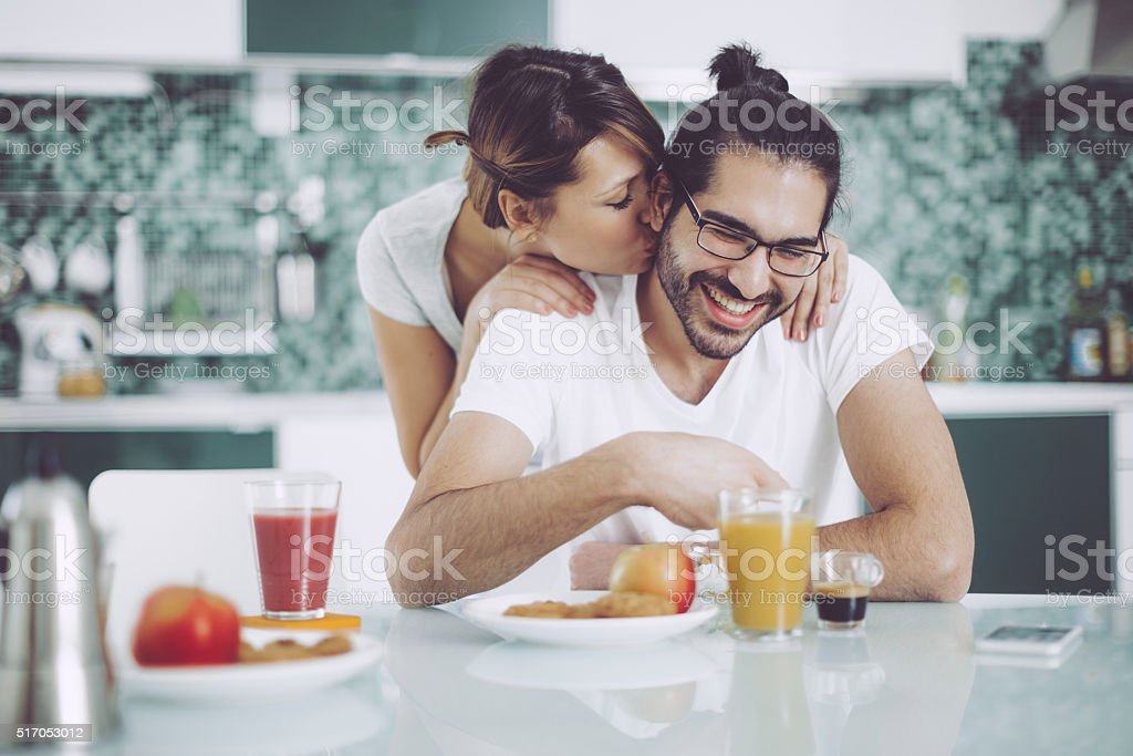 Young couple having breakfast stock photo