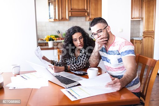 istock Young couple having finacial problems 827068950