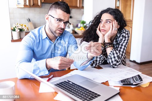 istock Young couple having finacial problems 831701084