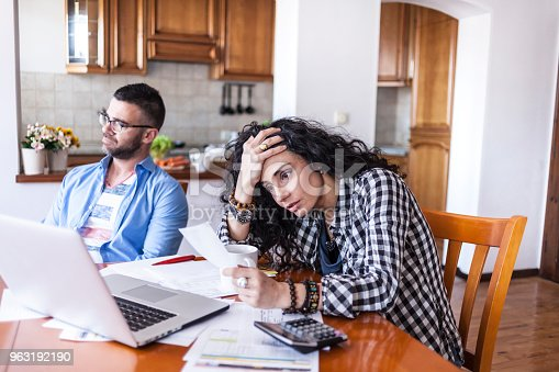 istock Young couple having finacial problems 963192190