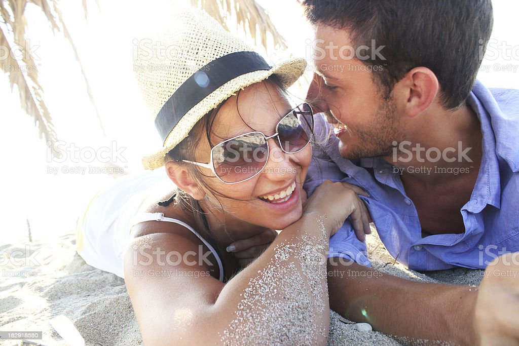 Young couple having fun at a beach royalty-free stock photo