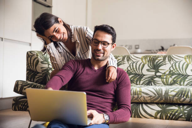 Young couple having fun at home stock photo