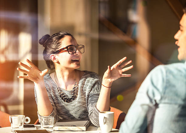 young couple having fun at the coffee shop - pics for cool girl stock pictures, royalty-free photos & images