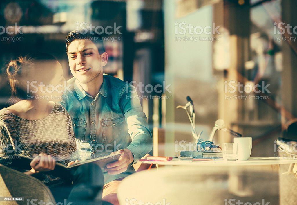 Young couple having fun at the coffee shop royalty-free stock photo