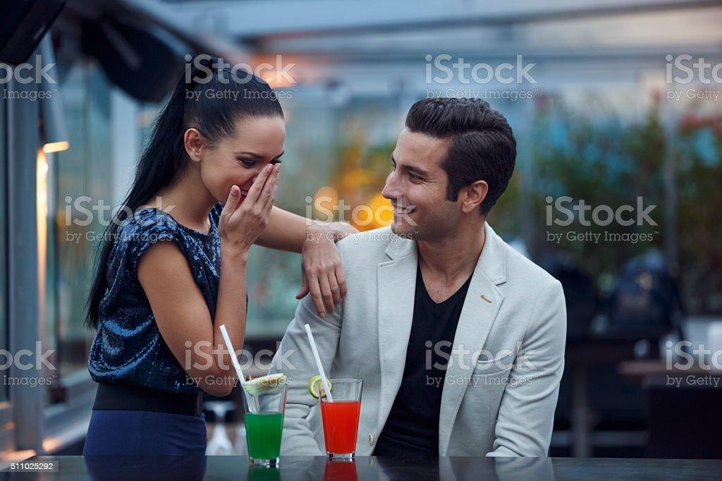 Young couple having fun in a club stock photo