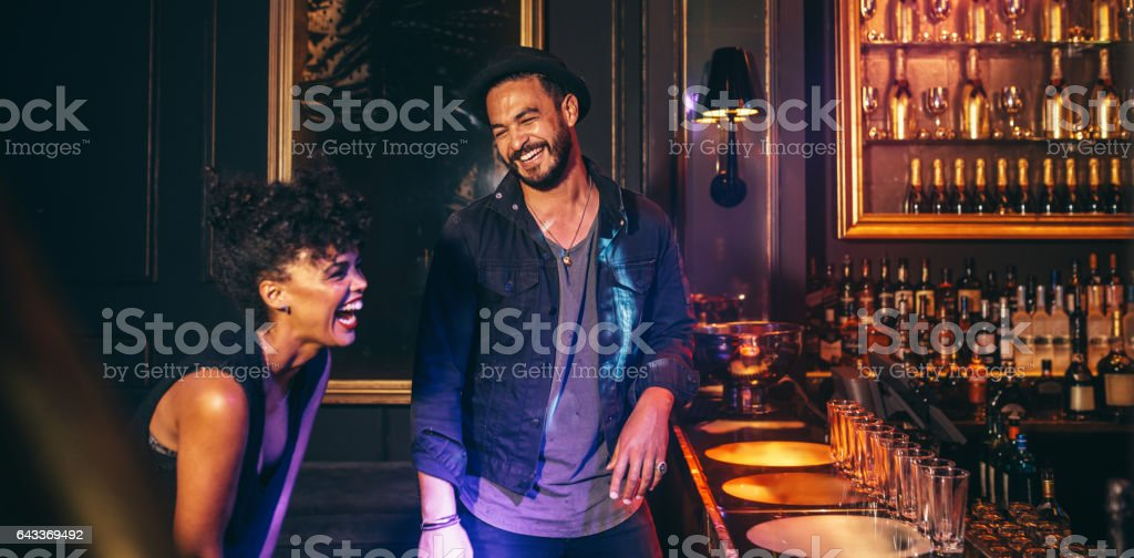Young couple having fun in a club stock photo