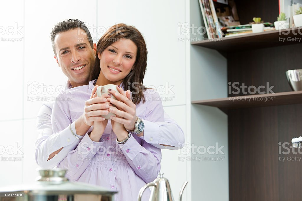 young couple having fun in the kitchen royalty-free stock photo