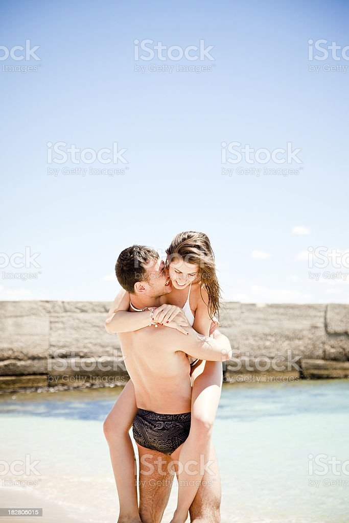 Young Couple Having Fun On The Beach royalty-free stock photo