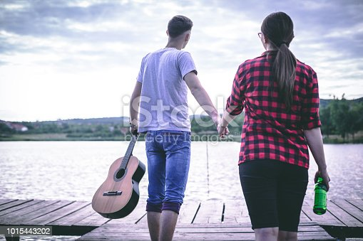 1083155024 istock photo Young couple having fun on the pier by the lake 1015443202