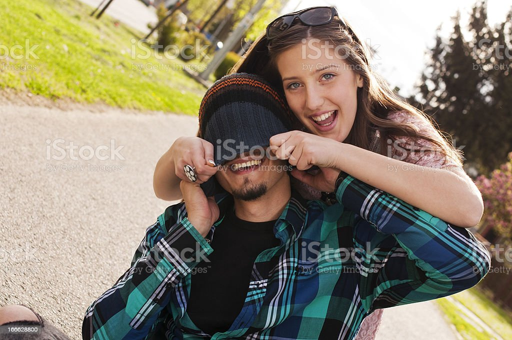 Young couple having fun on the sidewalk royalty-free stock photo