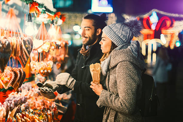 Young Couple Having Fun Outdoors At Christmas Time stock photo