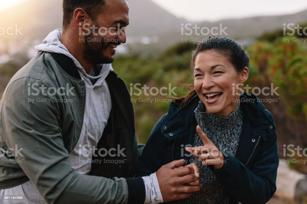 Young couple having fun outdoors on a vacation royalty-free stock photo