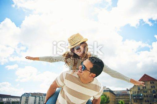istock Young couple having fun piggy backing 681729928
