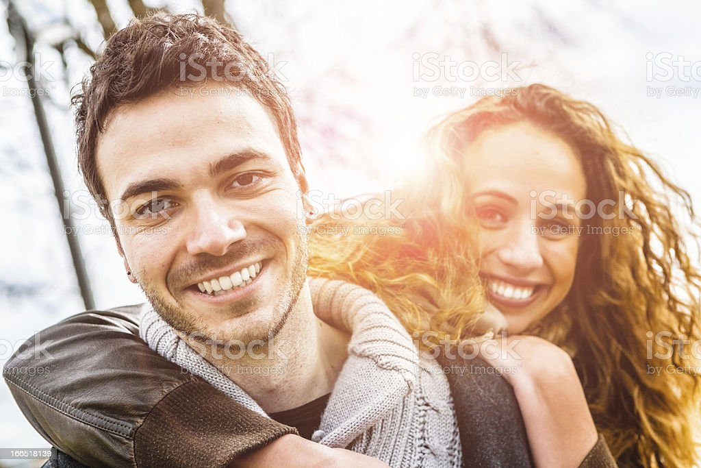 Young Couple Having Fun Together, Love at the Park stock photo