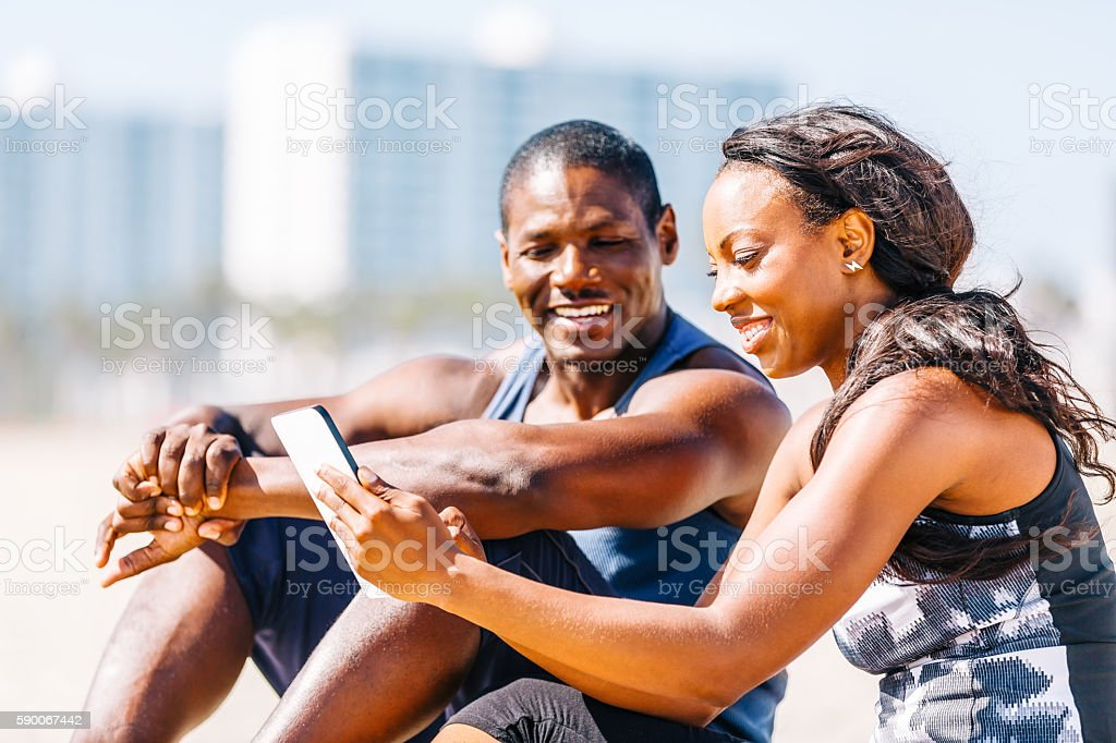 Young couple having fun with digital tablet stock photo