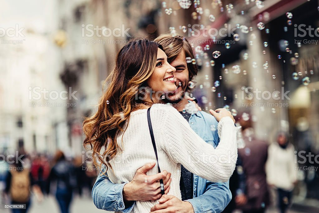 Young couple having great time on the street stock photo