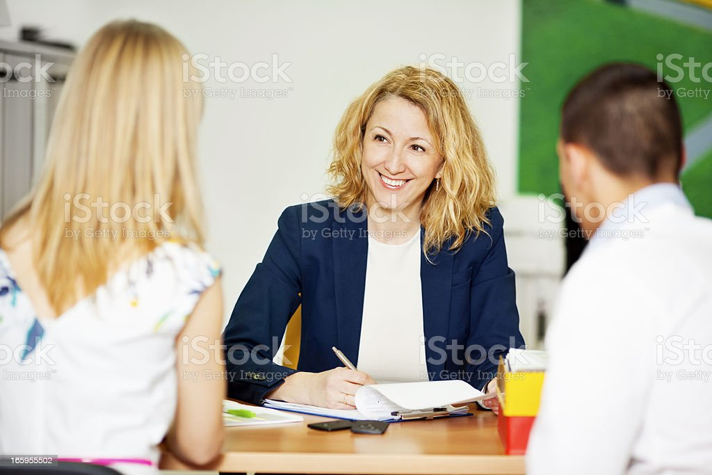 Young Couple Having Meeting With Financial Advisor. stock photo