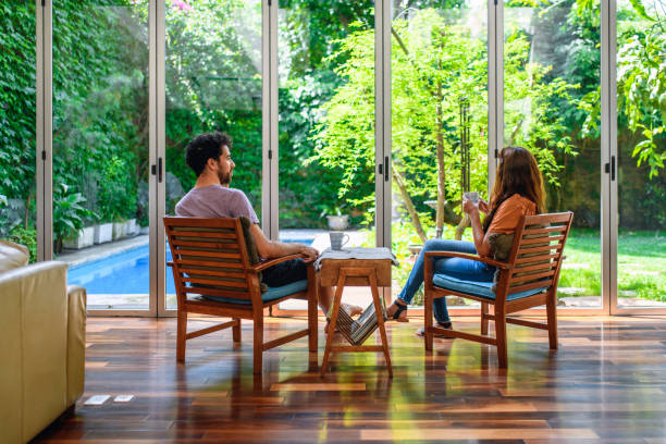 Young Couple Having Morning Coffee at Home in Sitting Area stock photo
