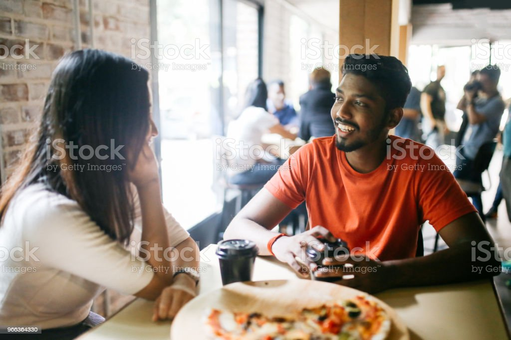 Young couple having pizza together stock photo