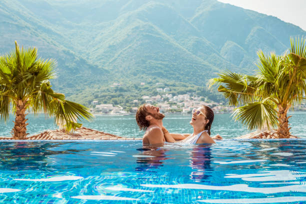 young couple having relaxing time in the pool Loving vacation real couples making love stock pictures, royalty-free photos & images