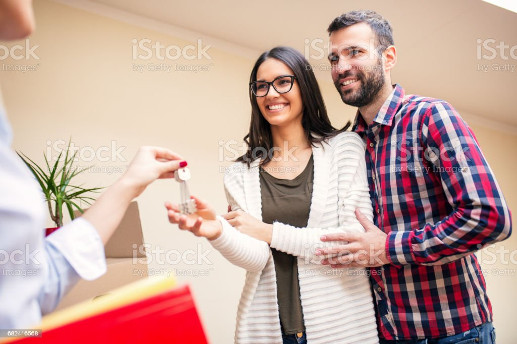 Young couple having their new home keys royalty-free stock photo