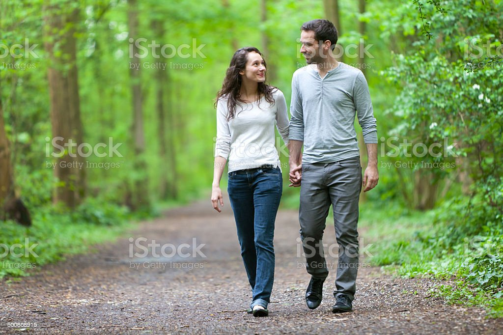 Young couple having  walk in a forest royalty-free stock photo