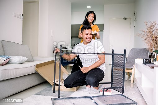 Couple Installing Table Together